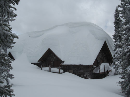 Sperry Chalet buried under snow.